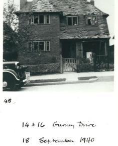 Photograph from an album showing air raid damage to Suburb houses after the Second World War