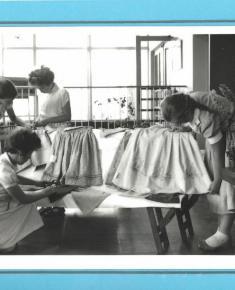 Dress-making class, labelled 1955